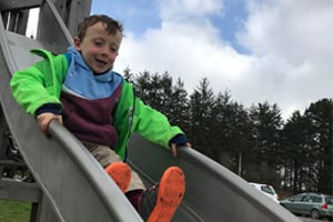Child on a slide at Siblyback Lake