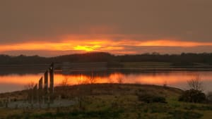Sunset overlooking Roadford Lake and the sundial